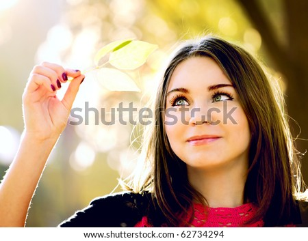 beautiful young woman in the autumn park - stock photo