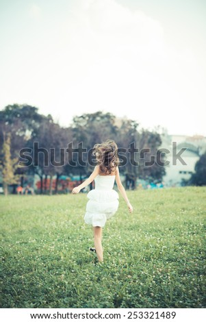beautiful young woman in the city - stock photo