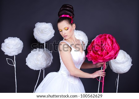 Beautiful young woman in the image of a fairy bride. A series of photos in my portfolio. Studio shot. - stock photo