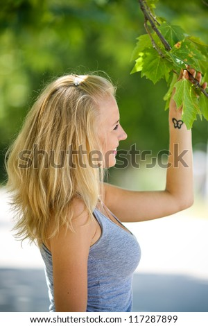 Beautiful young woman in the park. - stock photo