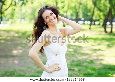 Beautiful young woman in the park. Outdoor portrait