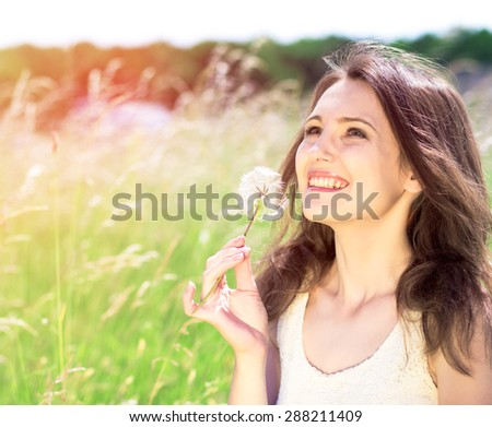 Beautiful young woman in the park. Outdoor portrait - stock photo