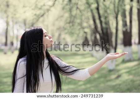 beautiful young woman in the summer park - stock photo