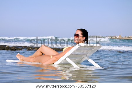 Beautiful young woman in the water - stock photo