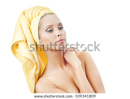 Beautiful young woman in towel - stock photo