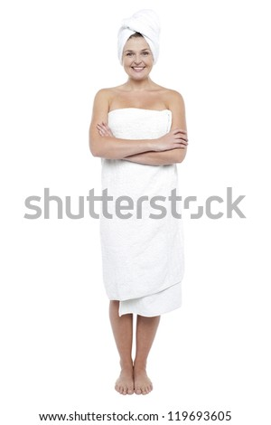 Beautiful young woman in towel after shower. All on white background - stock photo
