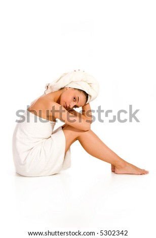 beautiful young woman in towel,against white - health and beauty