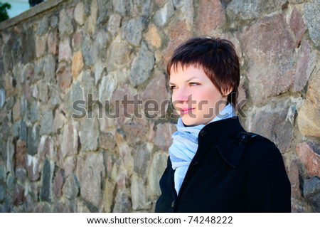 Beautiful young woman in urban background - stock photo