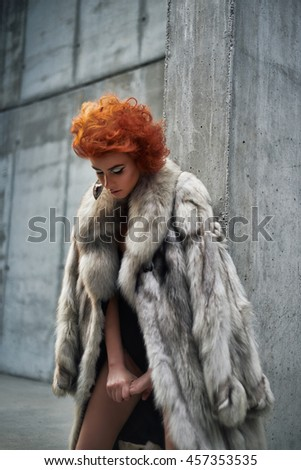 Beautiful young woman in vintage fashion fur - stock photo