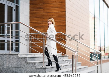 Beautiful young woman in white coat
