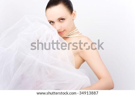 Beautiful young woman in white dress - stock photo