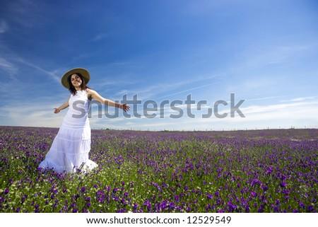 beautiful young woman in white dress enjoying nature - stock photo