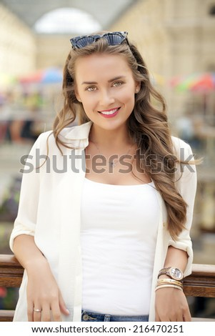 Beautiful young woman in white dress, indoor - stock photo