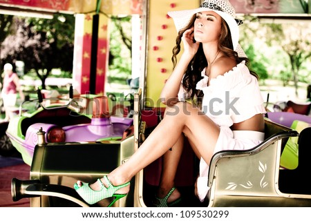 beautiful young woman in white dress outdoor in amusement park summer day - stock photo