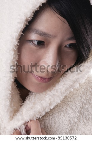 Beautiful young woman in winter outerwear on white as a snow princess - stock photo