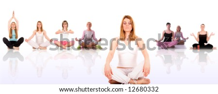 Beautiful young woman in yoga pose with blurred girl in background.