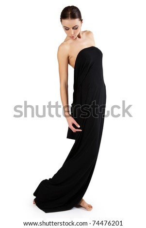 Beautiful young woman is covered with black cloth. - stock photo