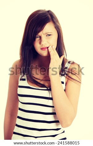 Beautiful young woman is having toothache.