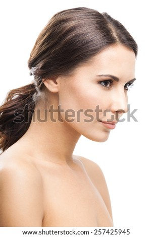 Beautiful young woman, isolated against white background - stock photo