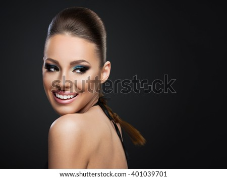 Beautiful young woman isolated on dark background  - stock photo