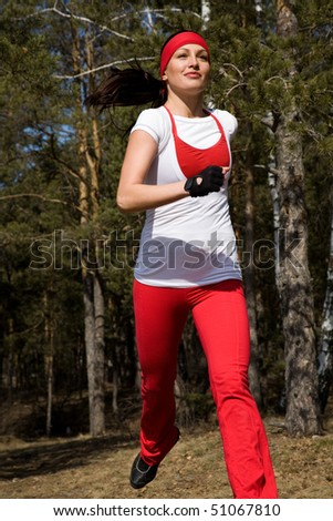 Beautiful young  woman jogging cross country