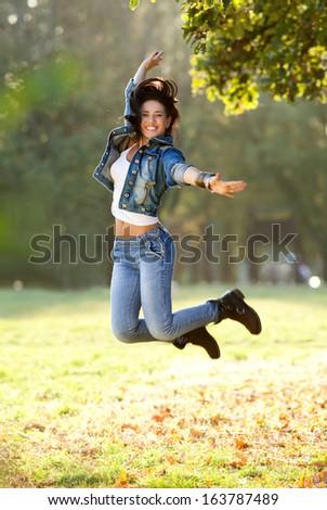 Beautiful young woman jumping  - stock photo
