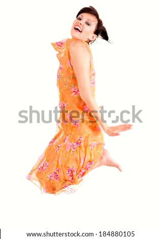 beautiful young woman jumping, white background - stock photo