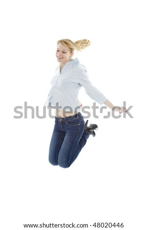 beautiful young woman jumping with arms raised, isolated on white - stock photo