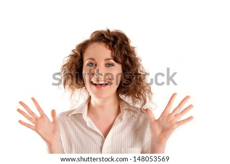Beautiful young woman laughing with her hands up in the air - stock photo