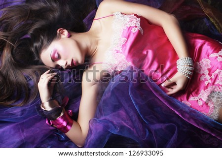 beautiful young woman lay on organza. Sleeping beauty.