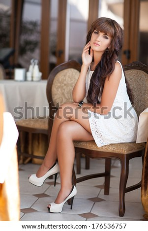 stock photo beautiful young woman lifestyle summer portrait sexy girl in white dress at cafe restaurant at 176536757 » An ideal Platform with respect to Model Brides to be