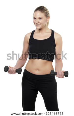 Beautiful young woman lifting dumbbells isolated over white background - stock photo