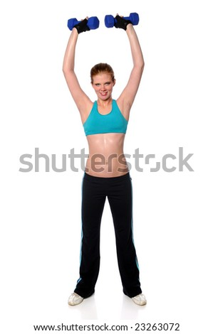 Beautiful young woman lifting dumbbells over her head - stock photo