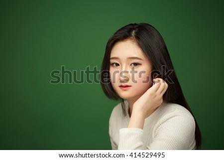 beautiful young woman listening music   - stock photo