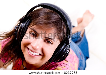 beautiful young woman listening music with headphones - stock photo