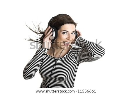 Beautiful young woman listening music with headphones isolated on white backgroun