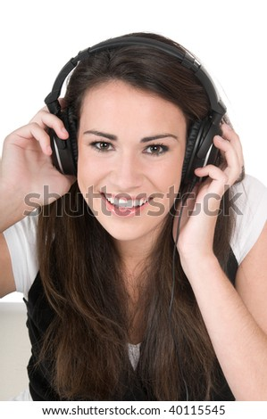 Beautiful young woman listening to music on headphones, happy and smiling, isolated on white background