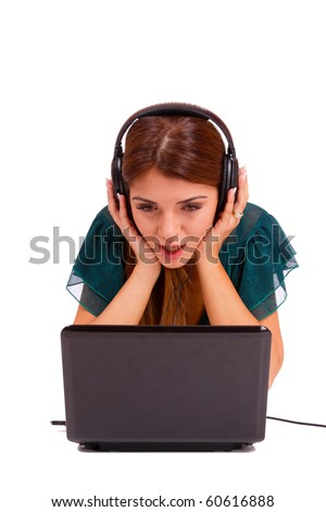Beautiful young woman  Listening to Music on her laptop - stock photo