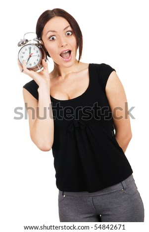 Beautiful young woman listening to the ticking of alarm clock - stock photo