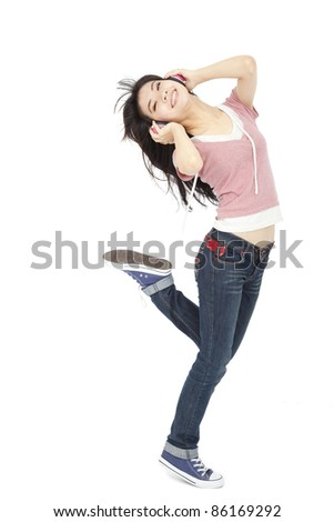 beautiful young woman listens to music and dances - stock photo