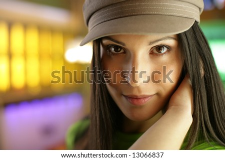 Beautiful young woman looking at camera, close-up. Shallow DOF. - stock photo