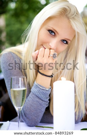 Beautiful young woman looking at you. - stock photo