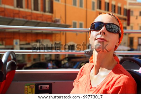 beautiful young woman looking on street of Rome in tour bus in Rome, Italy - stock photo