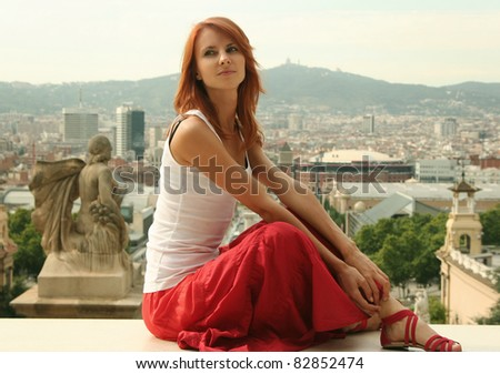 beautiful young woman looking over city