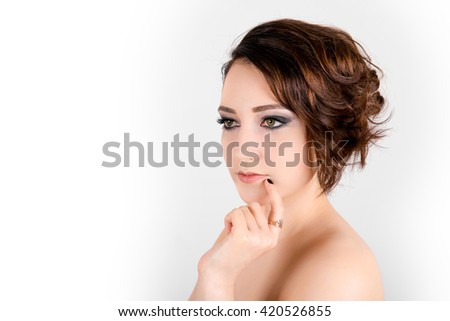 Beautiful young woman looking size in thoughtful and dreaming - white background. Portrait of a beautiful young woman  - stock photo