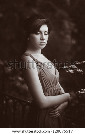 Beautiful young woman lost in reverie - stock photo