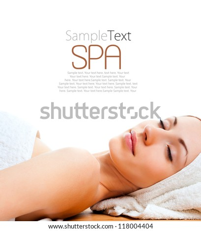 beautiful young woman lying relaxed over white with sample text