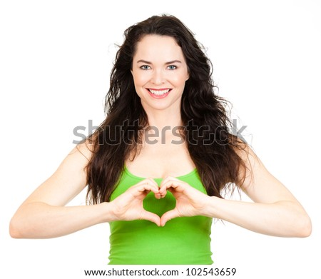 Beautiful young woman making a love heart with hands. Isolated over white.
