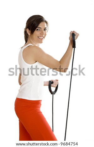 Beautiful young woman making exercise on the gym - stock photo