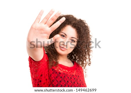 Beautiful young woman making stop sign with her right hand